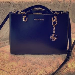 Black Michael Kors purse with gold hardware
